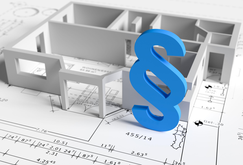 3d Bauplan auf dem Tisch. Bei der Hausbauplanung müssen die Bauvorschriften berücksichtigt werden